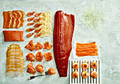 Smoked fish variety - smoked salmon, prawns and haddock and blini