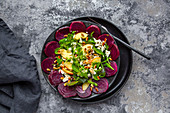Salad leaves with beetroot, apple, feta and roasted pine nuts
