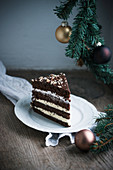 A piece of vegan hazelnut and chocolate buttercream cake with Christmas decoration