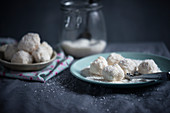 Vegan snowballs (biscuits with soy butter cream and grated coconut)