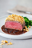 Pink fried venison with a nut crust
