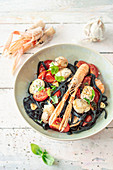 Black pasta with langoustines and scallops