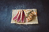 Grilled tuna steak with coarse sea salt and thyme