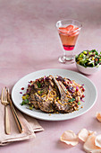 Lamb cutlets with pomegranate, rose couscous and rosé sangria