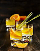 Homemade orange liqueur with lemongrass and star anise