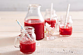 Homemade sour cherry liqueur in a bottle and glasses