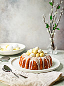 Coconut Easter cake with white chocolate eggs