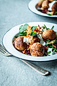 Falafel with vegetable salad, yoghurt sauce and mint