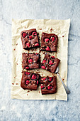 Chocolate brownie with raspberries made with rice flour