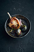 A grilled pork chop with star anise and figs