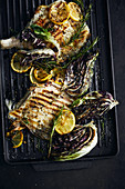 Ray fish, radicchio and lemons on a grill