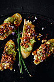 Crostini with lamb, chickpeas and chive cream
