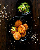 Oriental sesame seed fritters with cucumber salad