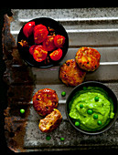 Sweetcorn fritters with mushy peas and roasted tomatoes