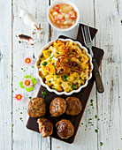 Swiss meatballs (Hacktätschli) with apple compote and Älplermagronen (a dish from the Swiss Alps made from pasta, potatoes, cheese, cream and onions)