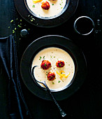 Celeriac and orange soup with spelt and thyme balls