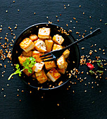 Fried tofu with sesame seeds