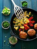 Veggie balls with scrambled egg, peppers and fresh herbs