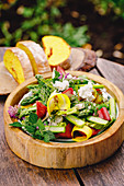 Early summer salad with rhubarb, green asparagus and goat's cheese