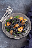 Black pasta with shrimp and scallops