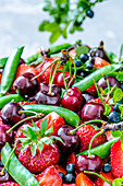 Colorful fruits, berries and peas