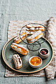 Eclairs with robiola cream and marmalade