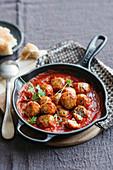 Chicken and quinoa balls in tomato sauce