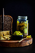 Pickled cucumber slices served with bread and cheese