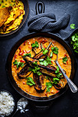 Roast Eggplant with Tomato Coconut Curry and Coriander Pudlas