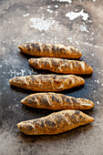 Lye baguettes with poppyseeds