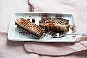 Vegan chocolate cake with sunflower seeds, hazelnut caramel and chocolate cream