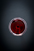 A glass of red wine from above