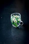 Daisy tea in a glass
