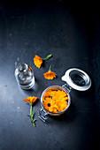 Marigold essence and fresh marigolds