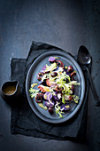 Frisee lettuce and octopus salad with purple potatoes