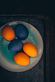 Easter eggs coloured with organic dyes on a plate