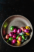 Chocolate eggs wrapped in bright foil