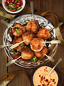 Breaded and fried shrimp skewers