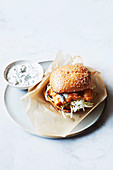 Beer battered flathead fish burger with sauce tartare and crisp slaw