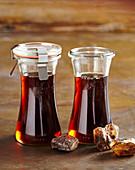 Homemade brown rock sugar syrup in preserving jars