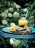 Spiced grilled meatballs with courgette relish