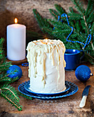 Cake with sour cream and white chocolate resembling candle