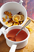 Homemade peach liqueur with cinnamon, lemon and vodka