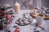 Chocolate crinkle cookies served on a ceramic plate in festive Christmas styling