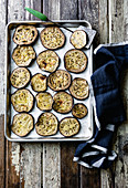 Roasted eggplant slices on a baking tray