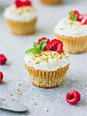 Raspberry pistachio cupcakes on the table