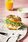 Home made bagel with prosiutto and clover sprouts