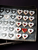 Linzer heart biscuits with jam and powdered sugar