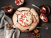Chocolate pavlova with pomegranate seeds