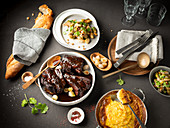 Beef ribs with potato gratin and silver onions